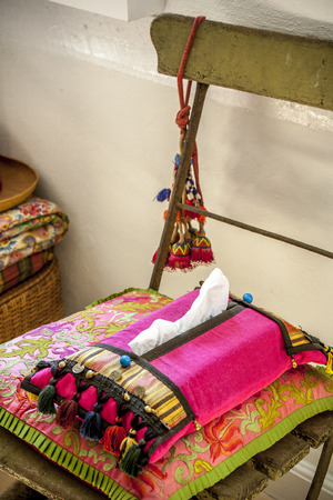lifestile: colorful mood interior image a chair, pillow and homemade pink napkin holder