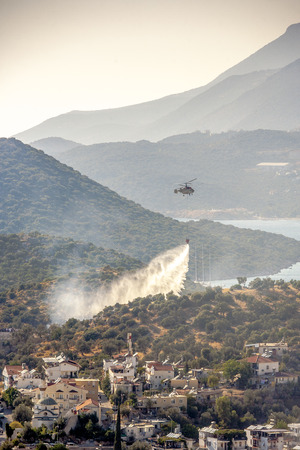 out of town: rescue helicopter goes out forest fire close to little town