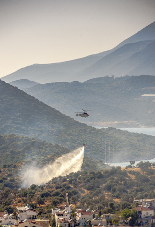 rescue helicopter: rescue helicopter goes out forest fire close to little town