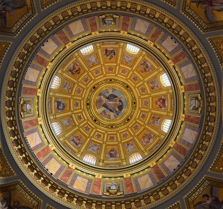 Fresco painting on the dome of a catholic cathedral church with religious images in color of saints and scenes of the Bible in color