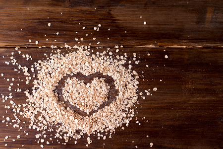 sprinkled: On vintage boards sprinkled on oatmeal, on which is painted a heart in honor of Valentines day.