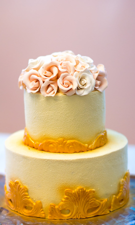 Festive wedding cake with flowers, yellow-orange flowers, bunk, beautiful