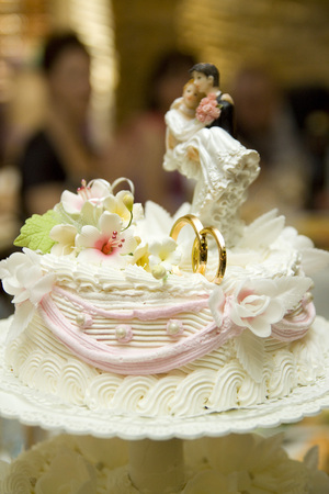 Decoration on wedding cake figurine of the bride and groom on the cake. Stock Photo