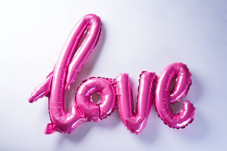 """Pink balloons in the shape of the word """"Love"""". Valentine's Day. Love concept. Holiday. pt of romance. Valentine's Day."""