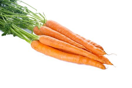 Fresh carrots with leaves on white isolated Stockfoto
