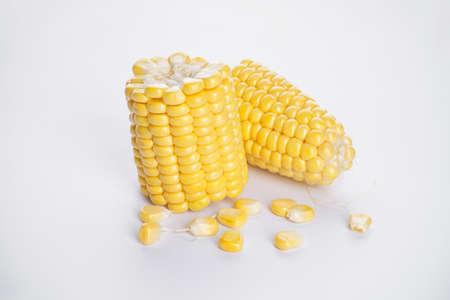 Fresh corn with grains on a white background Archivio Fotografico