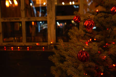 Christmas tree on the background of a wooden window. Close-up. Stock fotó