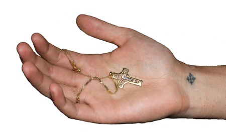 follower: a religious cross in Hand isolated Stock Photo