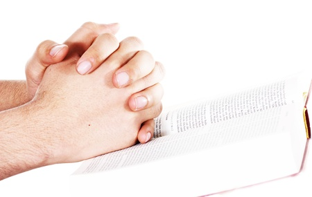 Praying hand hold an open bible photo