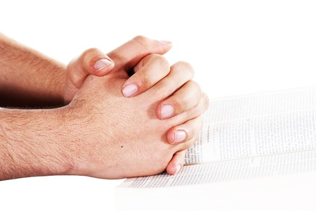 Praying hand hold an open bible Stock Photo