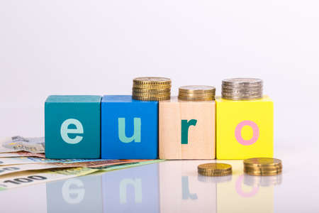 pile of paper and metal euro banknotes and coins on a white background with lettering as part of the united country's payment system. © Michele Agostinis / Visualbrand Photography Stock fotó
