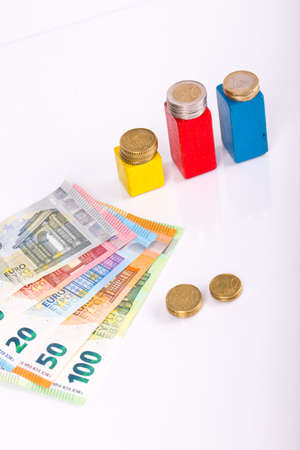 pile of paper and metal euro banknotes and coins on a white background as part of the united country's payment system. © Michele Agostinis / Visualbrand Photography Stock fotó
