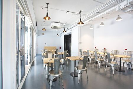 this is photo of interior design with gray tables and floors and white walls with best quality and high resolution for you. Zdjęcie Seryjne