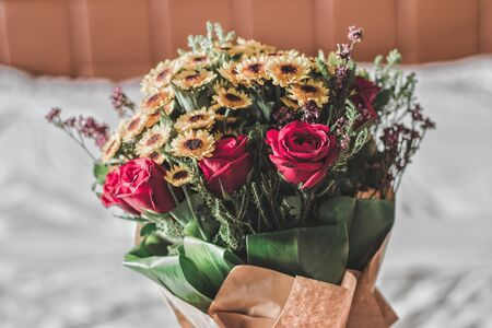red roses with many colorful flowers neatly arranged with motion blur
