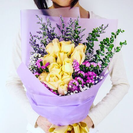 yellow flowers and many other flowers in one container Stock Photo