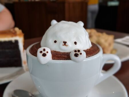chocolate coffee with bear-shaped cream in a cup