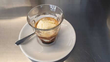 cappuccino with ice cream in a glass on the table