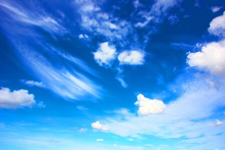blue overlay clouds and beautiful blue sky background with clouds and sunlight beams on background