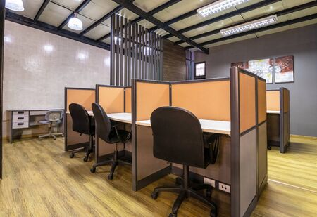 co working space modern style room with black chair,brown table stylish room with soft lamp on background