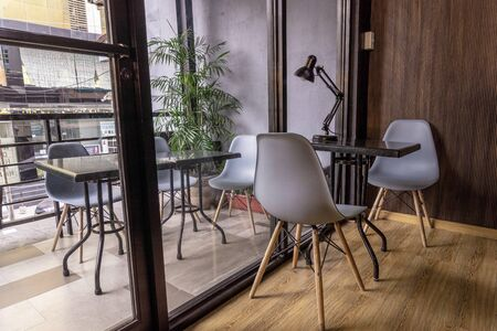 co working space modern style room with white chair,white and brown table stylish room with soft lamp on background