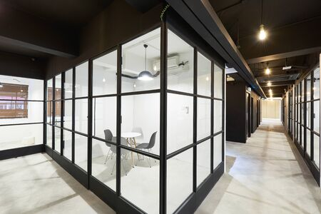 creative co working space office center with white chair,white table,white wallpaper modern open space or shared workplace