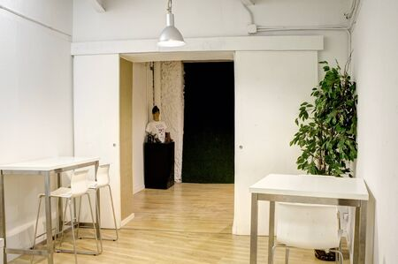 interior co working space rows with concrete white walls,white table and conference room front view background Imagens