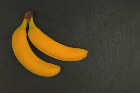 banana fresh fruit in row isolated assortment clipping pat on black background