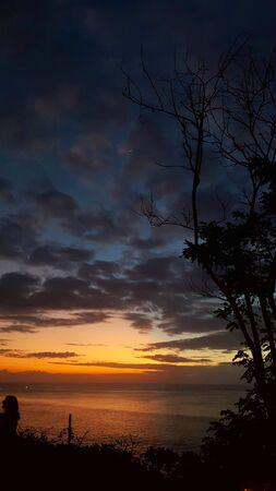 dark orange beautiful sunset view sky blue clouds with dramatic light on paradise tropical sea island 版權商用圖片