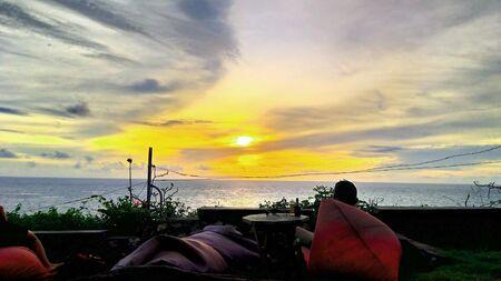 orange light beautiful sunset view orange clouds with dramatic light on paradise tropical ocean island