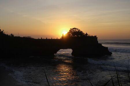 orange beautiful sunset view orange clouds with dramatic light on paradise tropical ocean rock island 版權商用圖片