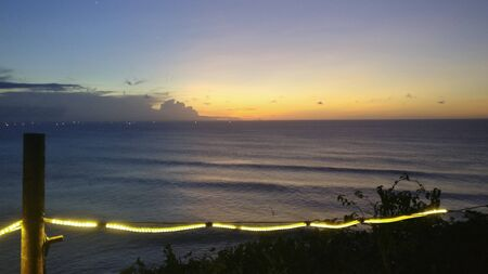orange beautiful sunset view sky dark blue clouds with dramatic light on paradise tropical ocean island