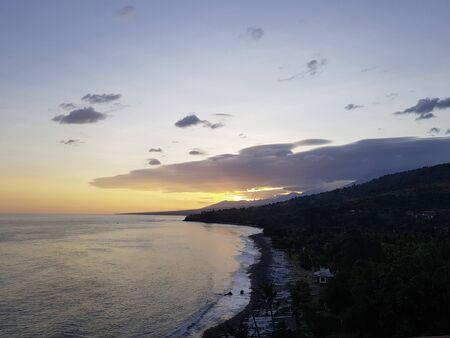orange light beautiful sunset view sky above blue clouds with dramatic light on paradise tropical ocean island 版權商用圖片