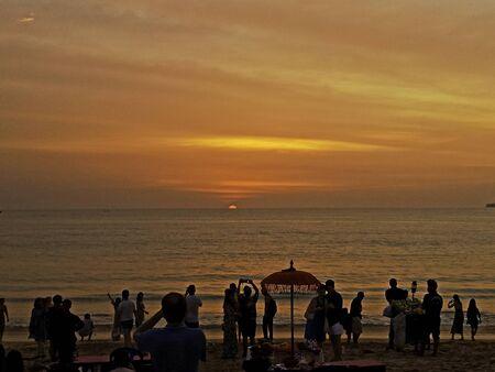 dark orange beautiful sunset view sky orange clouds with dramatic light on paradise sea afternoon island