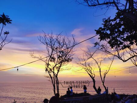 dark orange beautiful sunset view sky yellow clouds with dramatic light on paradise tropical sea island 版權商用圖片