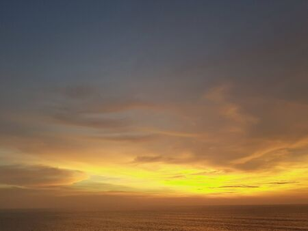 yellow beautiful sunset view sky orange clouds with dramatic light on paradise tropical sea island