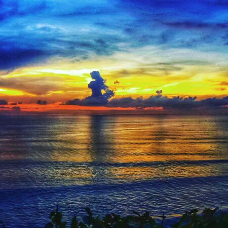 orange and yellow beautiful sunset view sky above clouds with dramatic light on paradise tropical ocean island 版權商用圖片