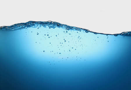 blue transparent water wave splash abstract with water bubbles on white background.