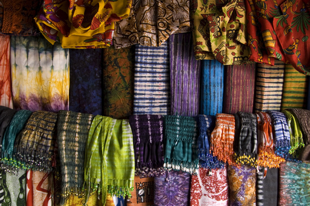 Shop of colorful canvases and scarves in Gambia