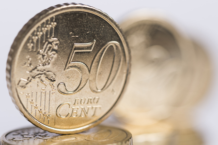 golden euro coins lined up Stock Photo
