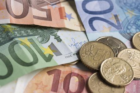 Saving euro coins and notes Stock Photo