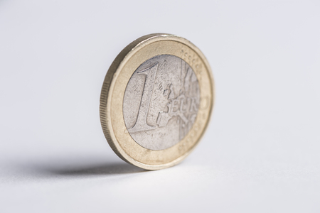 used 1 Euro coin standing