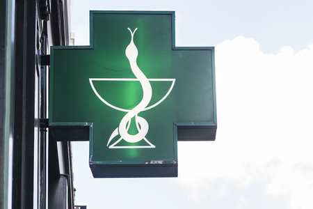 typical green signboard at a pharmacy store