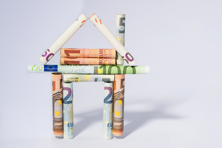 house mortgage creative concept represented by house of european money currency Stock Photo
