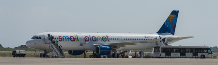 Travellers disembarking Small Planet Airlines plane Poland Airbus A321-200 with registration SP-HAZ at the Rhodes international airport
