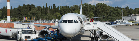 Panorama of Thomas Cook A320 Airbus at the airport of Corfu with pilot giving instructions