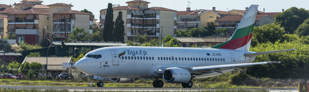 Bul air Boeing 737 with registration LZ-BOO at runway of Corfu internation airport, showing the close distance between the runway and houses