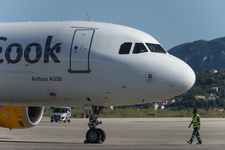 Technician doing the last checks on Thomas Cook A320 Airbus at the airport of Corfu before departure Sajtókép