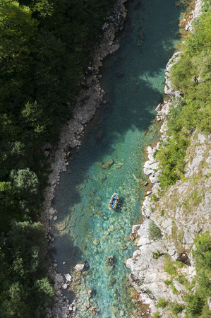aerial view down the Tara river Canyon Gorge from Tara Bridge, looking at rafters in a raft Stok Fotoğraf