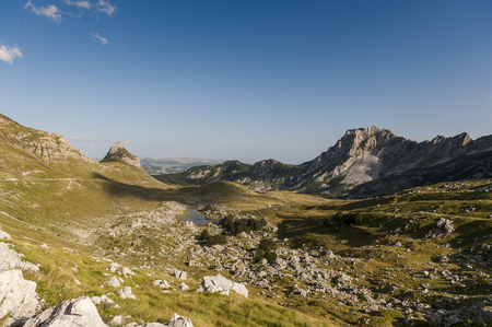 Landscape image with nice cloud shadows, along the high altitude roads in Durmitor national park