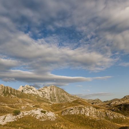 Mountains at Durmitor with a nice cloud sky and sunlight Stok Fotoğraf